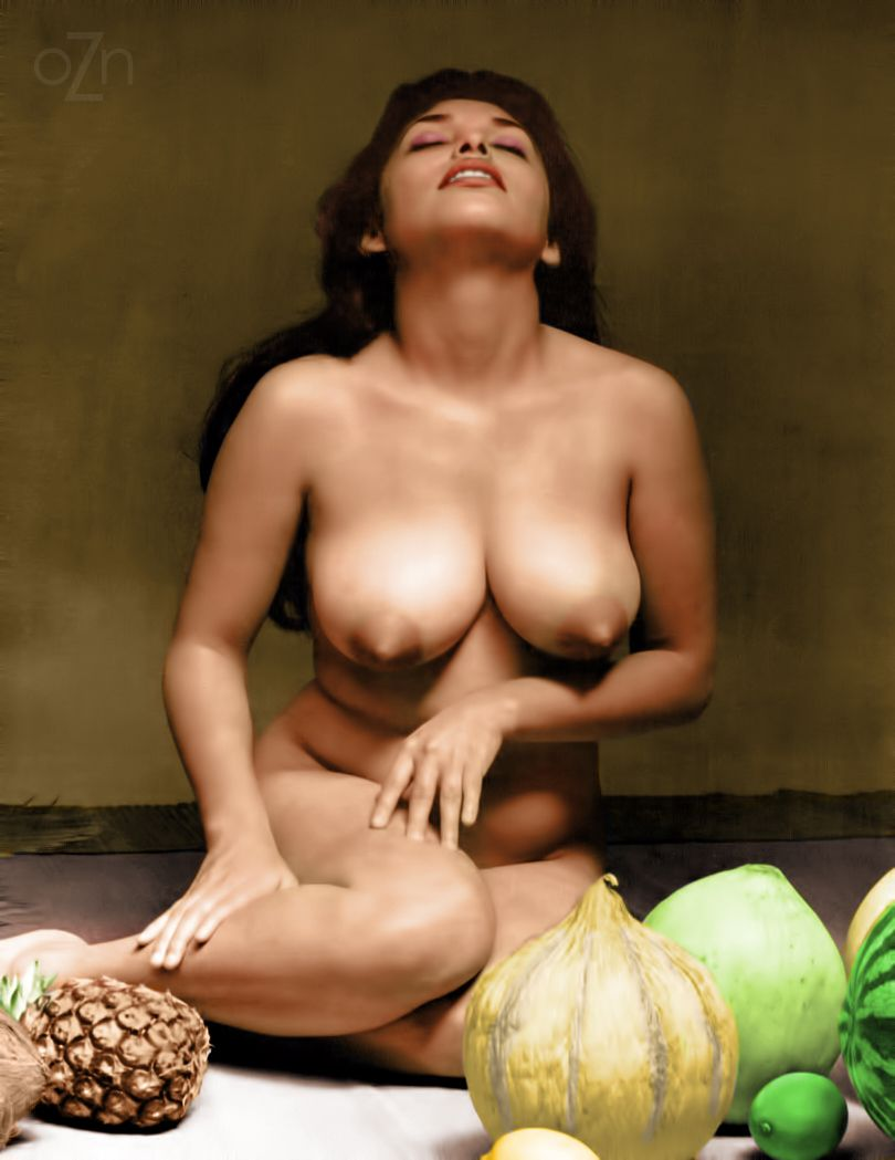 naked lady in a fruit pyramid