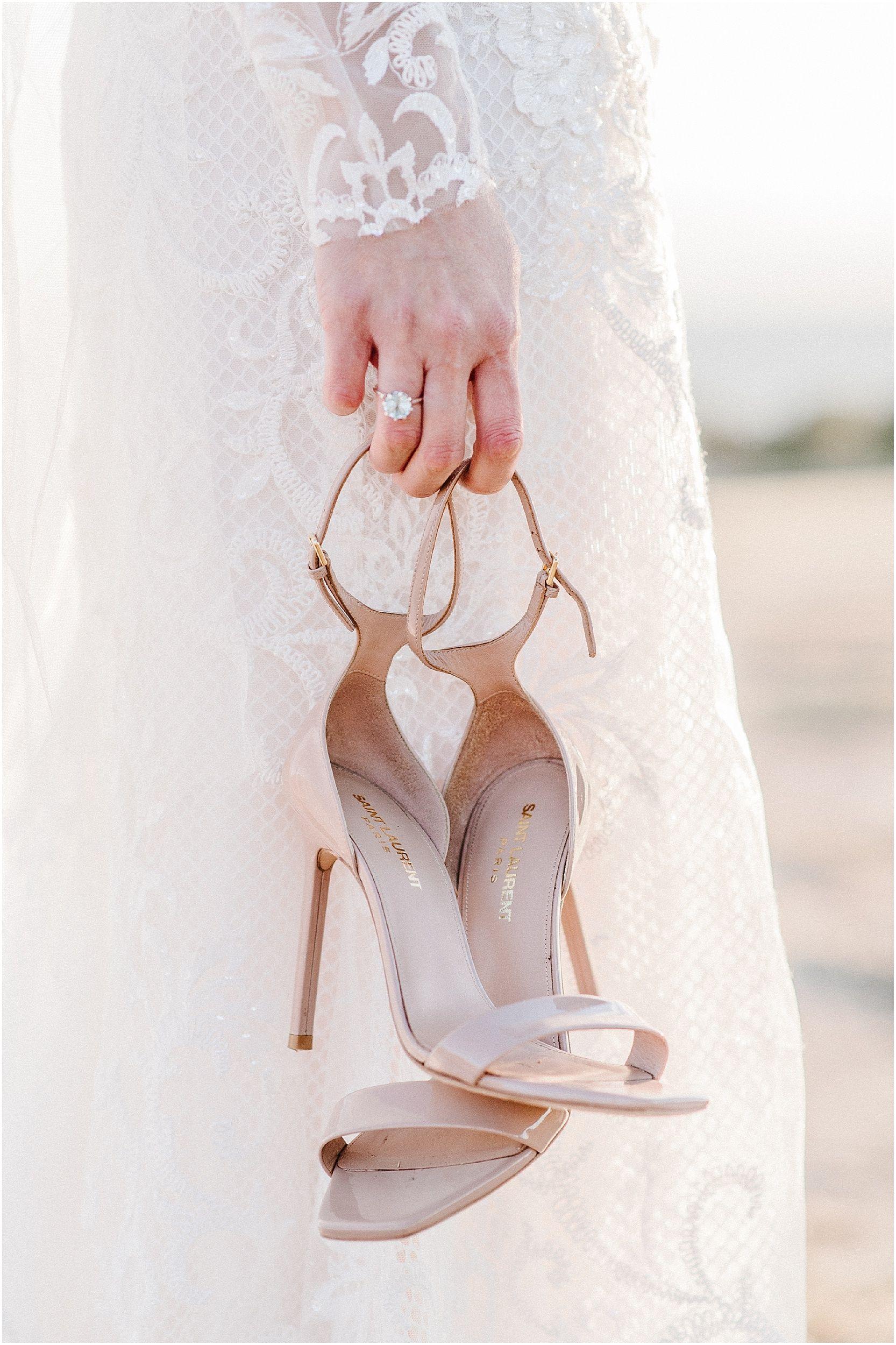Red dress shoes for wedding  Nicole Jansma Photography Long Sleeve Lace Wedding Dress Rivini Rita