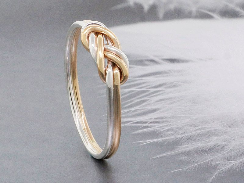 14k solid gold and sterling silver climbing knot ring tied and