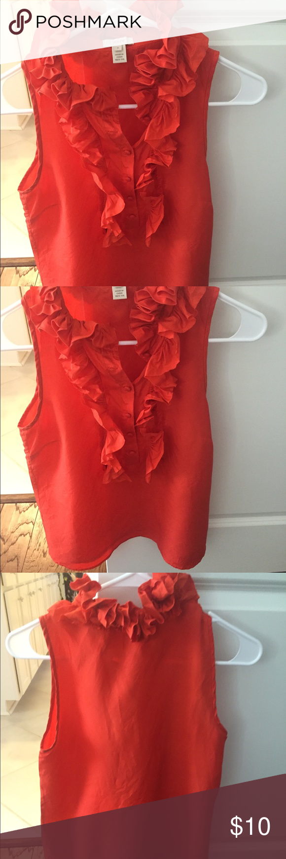 Jcrew blouse Orange silk Jcrew blouse with ruffled color! So cute! There is a small water stain on back at top, but you can barely see it. Should come out when dry cleaned! J. Crew Tops Blouses