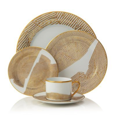 Kelly Wearstler's Bedford china showcases the designer's signature raw-yet-refined aesthetic. Bold metallics and dramatic shapes combine for a look that's ultra-modern yet timelessly elegant.   China/