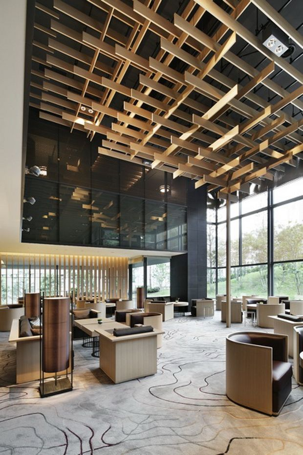 Designed by the renowned architect kengo kuma the capitol for Hotel ceiling design