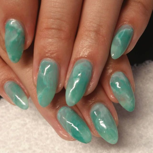 Jade green shiny nail design
