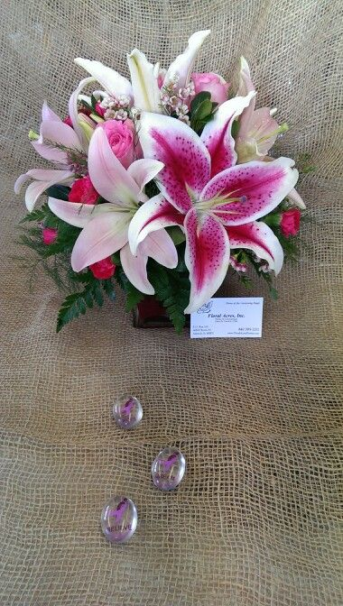 Fl Arrangement Of Stargazer And Pink Asiatic Lilies Hot Elegance Waxflower Leather Tree Fern In Gl Cube