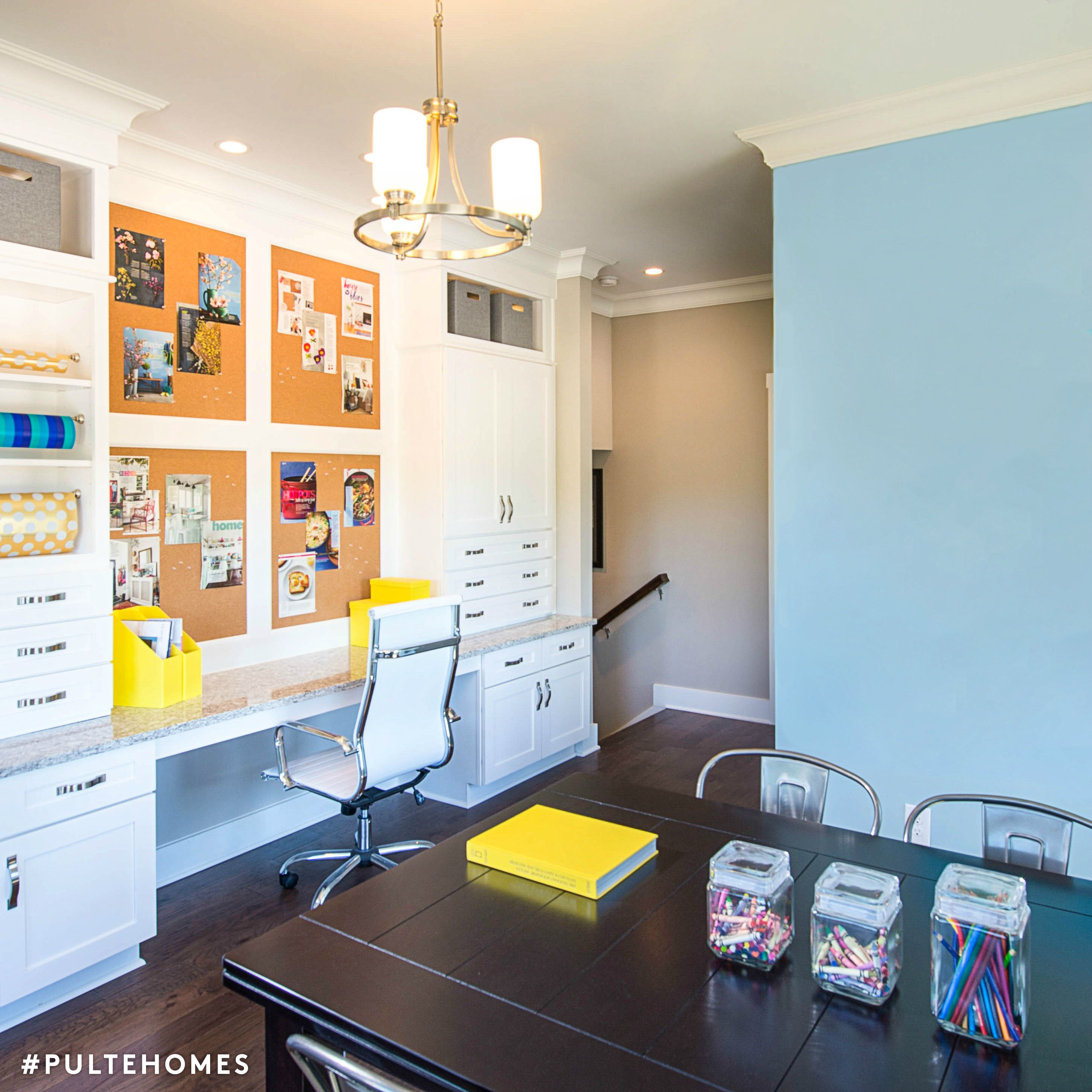 A functional flex room with a desk for grown ups to work