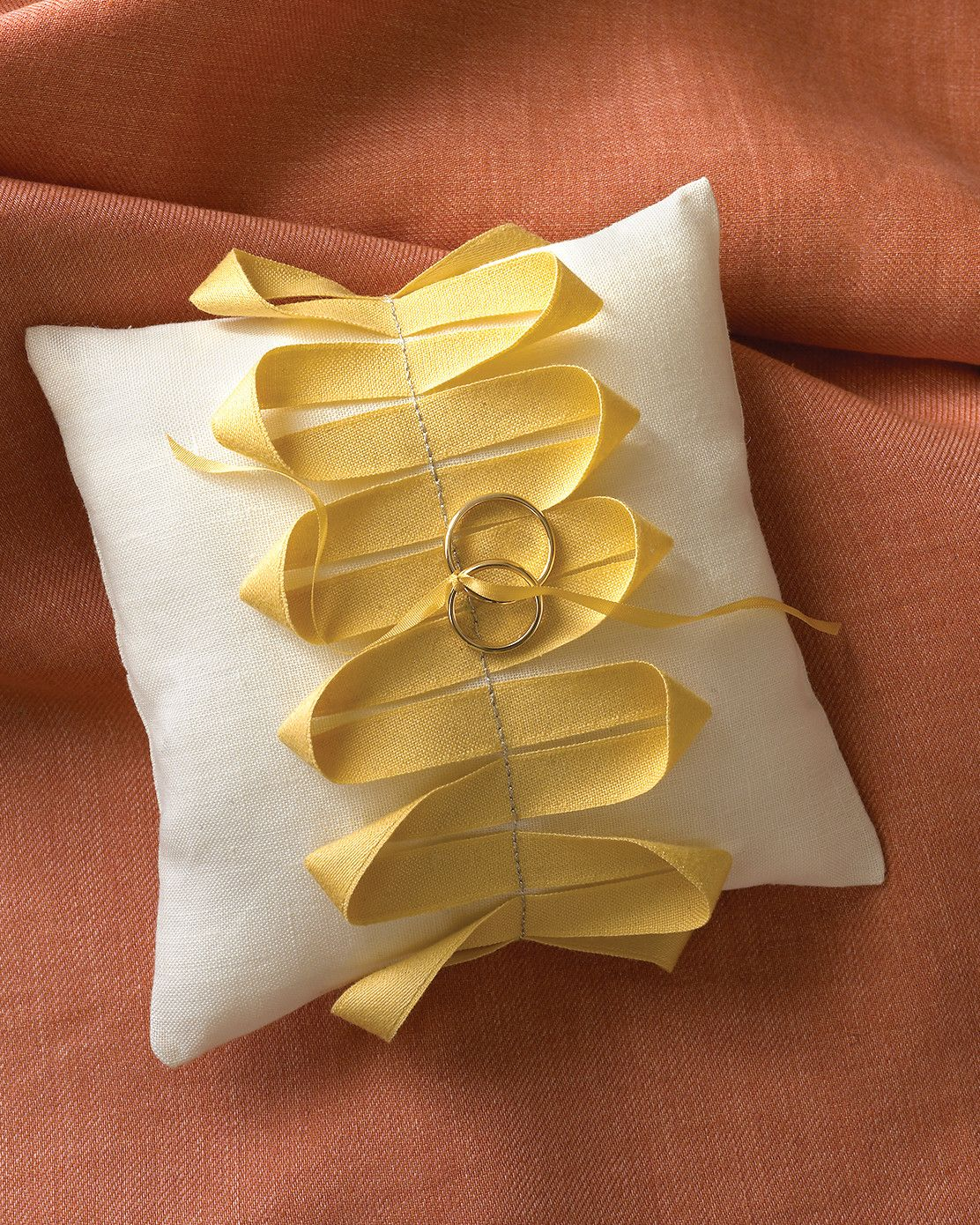 For the ring bearer consider this linen ring cushion decorated