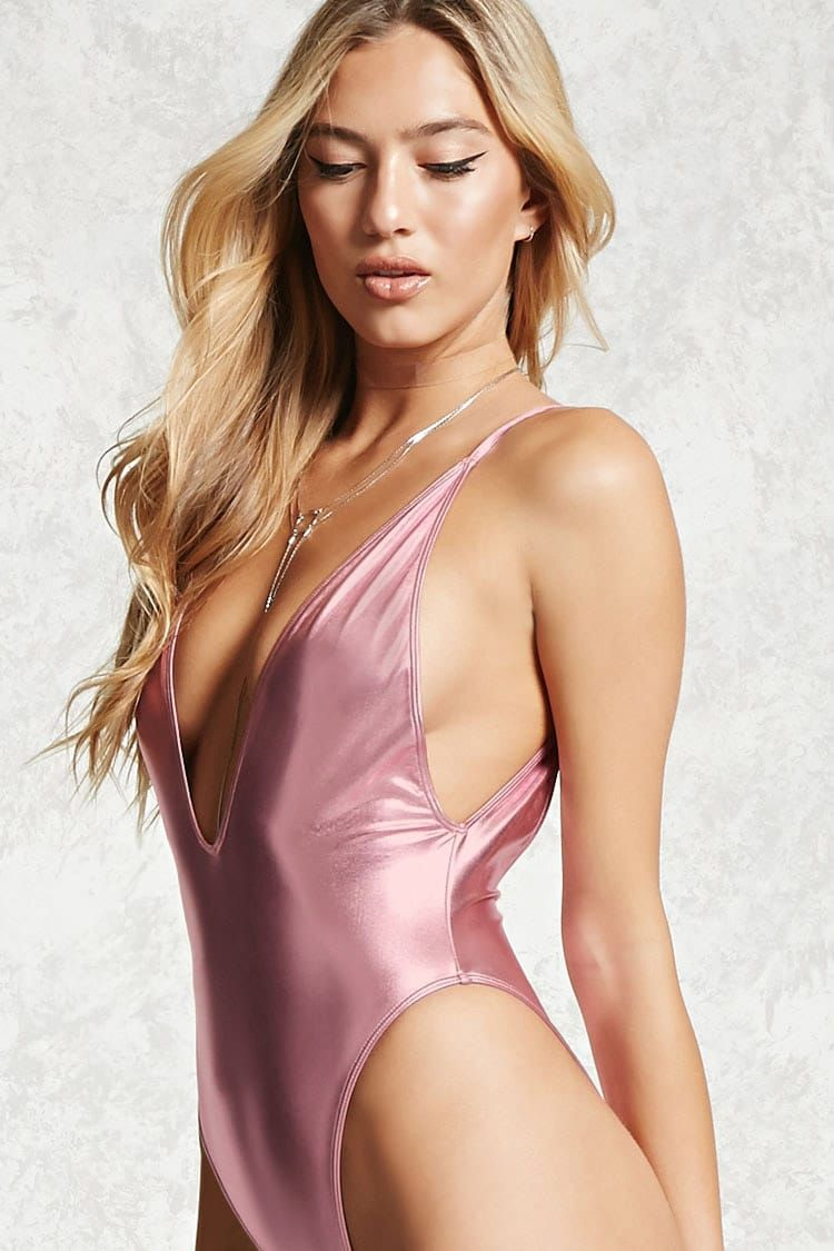 bc2d3a1831b7f A metallic knit one-piece swimsuit featuring a plunging V-neck, cami  straps, drop armholes, a high-leg, and cheeky fit.