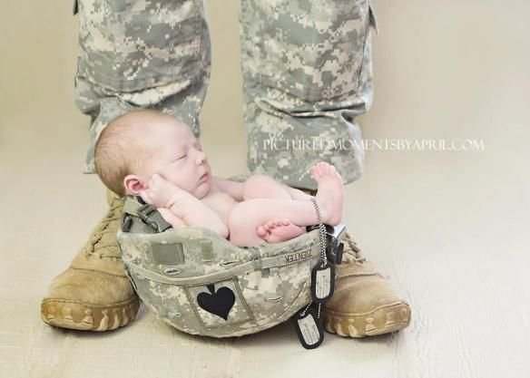 newborn baby boy sleeping in his daddys army helmet from fort campbell ky 101st airborne division screaming eagles
