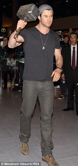 Chris Hemsworth. And he is carrying the magic hammer!! Sigh.