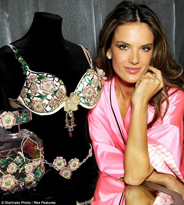 Victoria's Secret model Alessandra Ambrosio admiring a gem studded bra reportedly worth more than 2.5 million dollars. The Fantasy Bra was covered in intricate flowers made out of a massive 5,200 precious and semi-precious stones. The gems include amethysts, sapphires, rubies and white, pink and yellow diamonds. via dailymail.co.uk