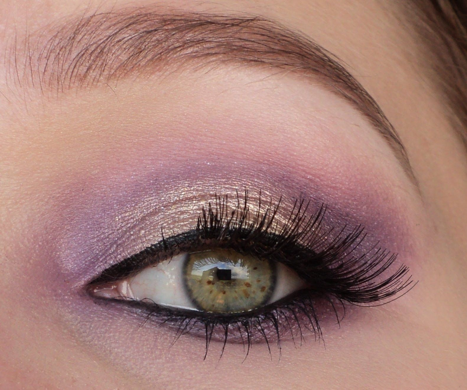 Gradient eyeshadow with hues of gold and purple, add a set of falsies to amp up the drama.