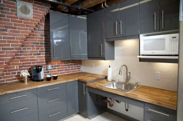 Kitchen l shape dark grey kitchen cabinet red brick wall for Grey kitchen cabinets with red walls