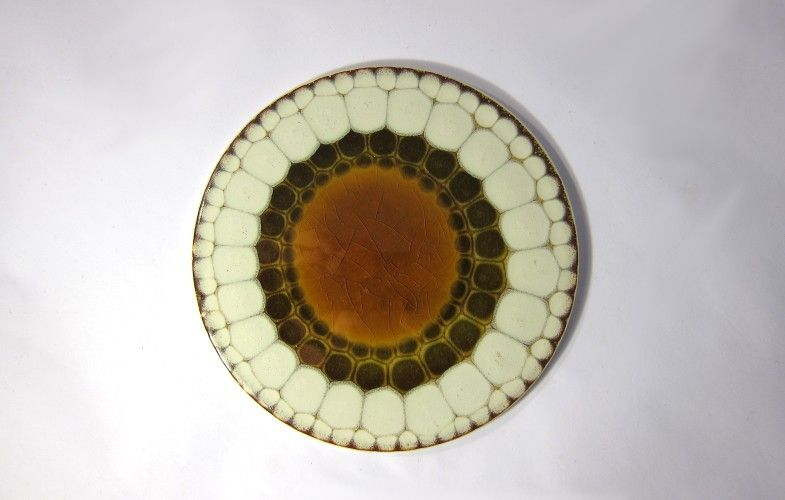 Alan Wallwork round tiles —  These are more typical of the type of tiles that you are likely to find. I'm unsure of the date. There were produced in large numbers by a team of girls at Marnhull, North Dorset 1965 - 1984