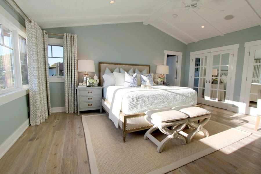 Steely light blue bedroom walls, wide-plank rustic wood ...
