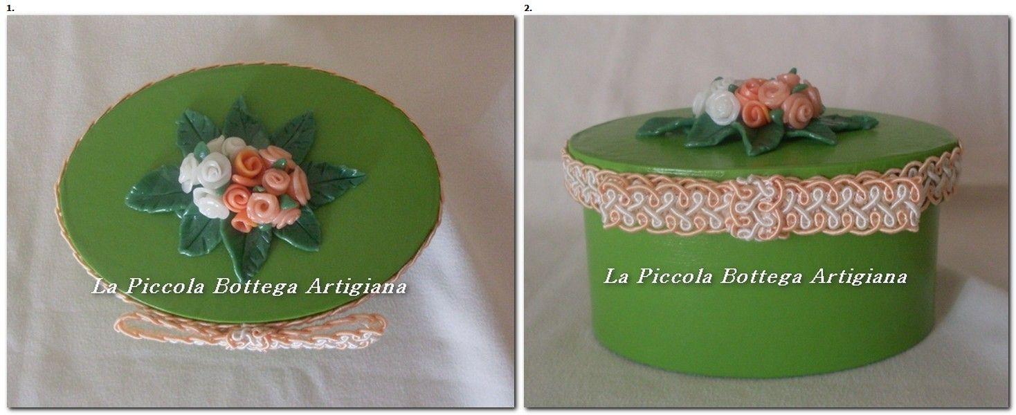 Scatola in cartone ovale cm. 12x6,5,x6,5 trattata con acrilico verde e decorata con fiorellini in pasta di mais e passamaneria