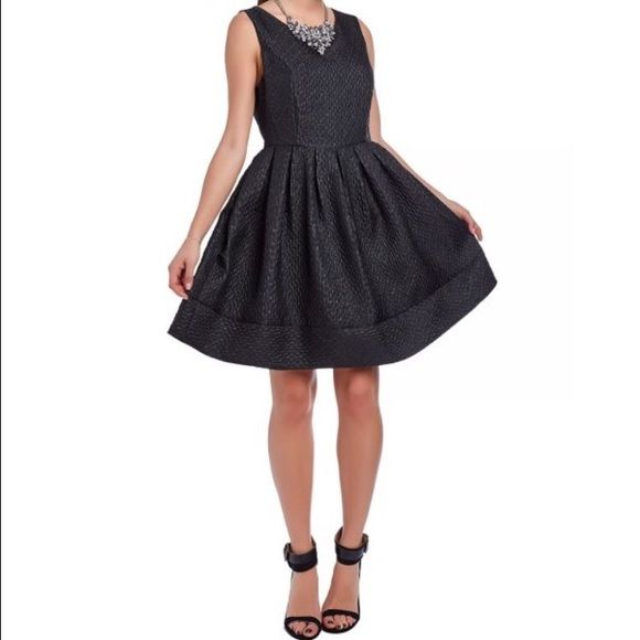 Black Dress Black brocade skater dress with full lining. Cut-away sleeves with zip back and round neckline. Fit and flare shape. When you're hoping to get away from the ordinary slip into the extraordinary into the skater dress!        M&L AVAILABLE Dresses Mini