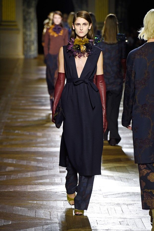 Plunging neckline dress worn over trouser pants with leather gloves for Dries van Noten F/W 2015 Collection