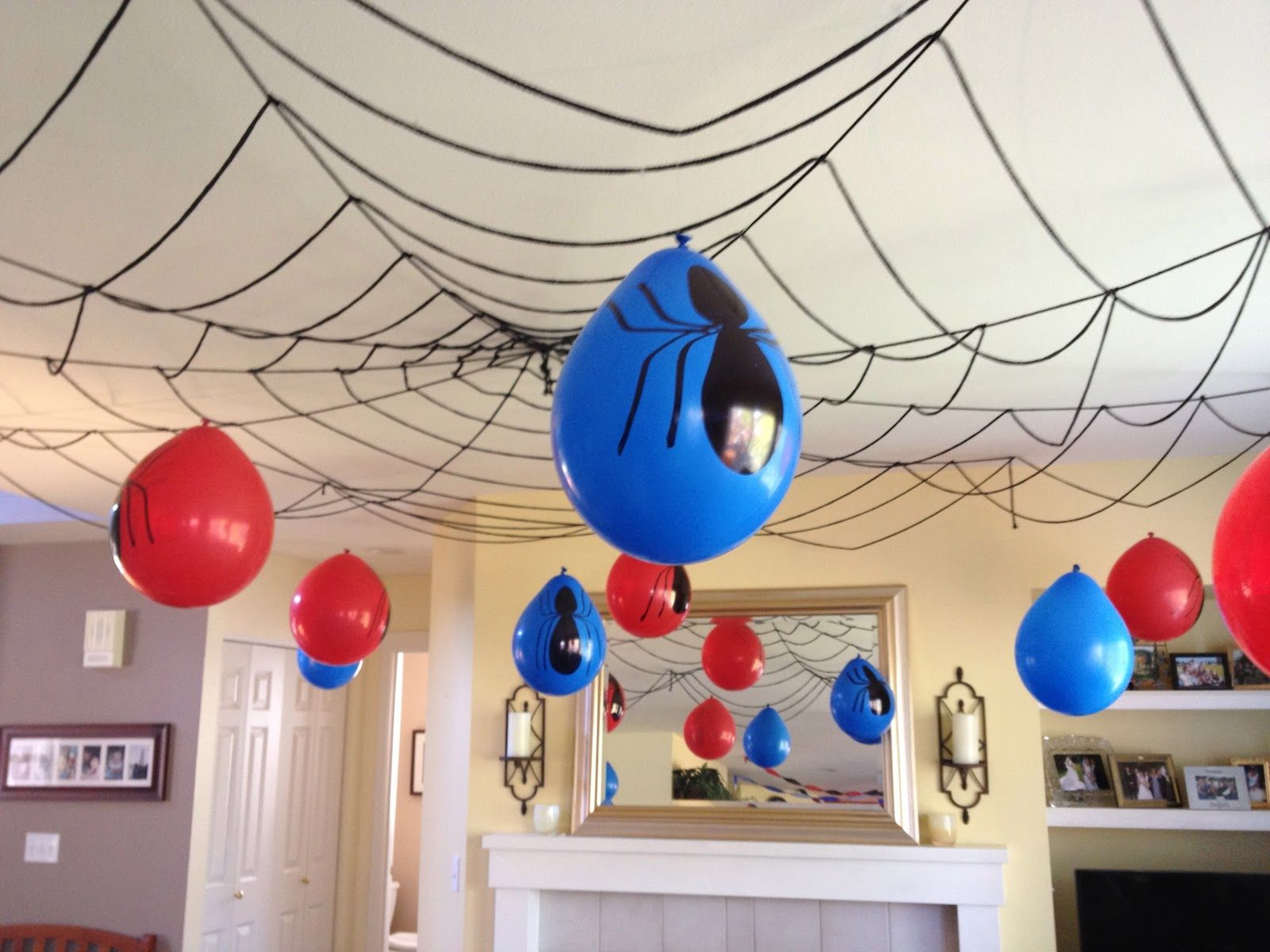 Web ceiling decor spiderman birthday pinterest for Party decorations to make at home