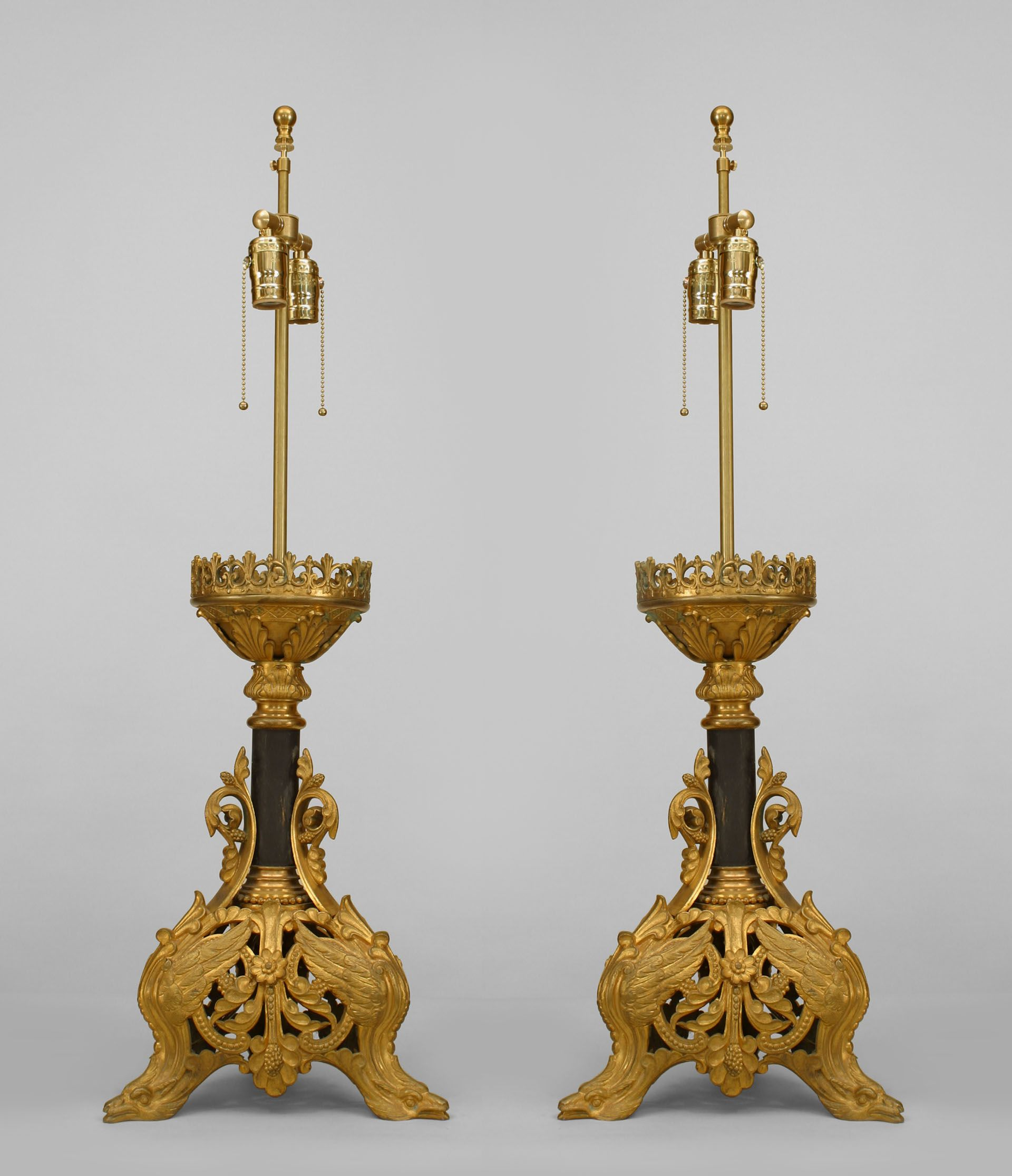 Pair of Italian Renaissance style (19/20th Cent) gilt bronze filigree base altar sticks mounted as lamps with 3 winged bird head legs and an ebonized center post