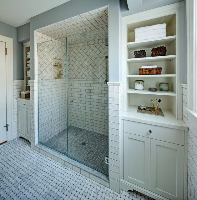 large shower room screened by glass shower screen at traditional bathroom with white tile backsplash also