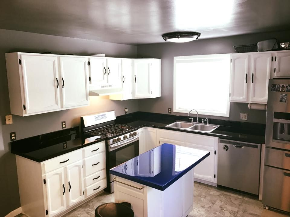 Blue and black epoxy countertops with white cabinets for ...