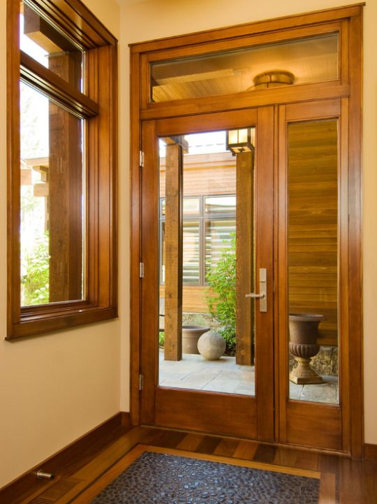 Beautiful Asian Entry With Wood Trim Hardwood Floors With Custom