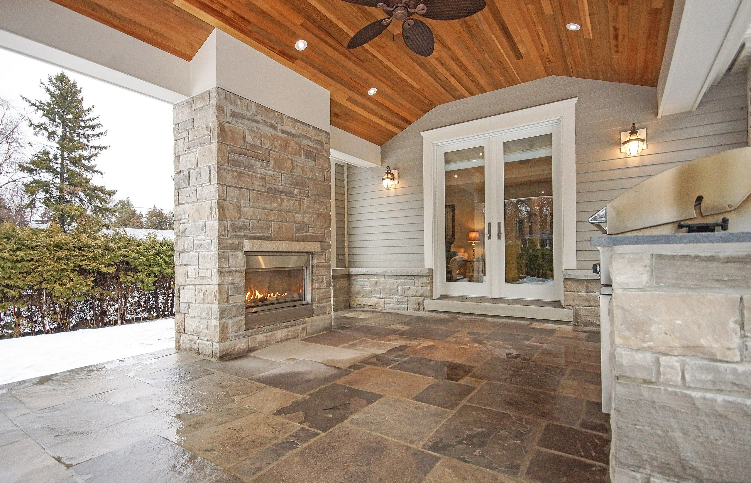 covered porch with built in fireplace and bbq home decor ideas