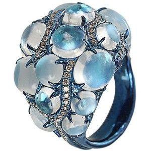 Arunashi's blue moonstone ring. Titanium. Blue Moonstone (16.49 CTW) Sapphires (1.32 CTW) Diamonds (1.06 CTW) ($24k)