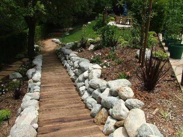 Re-purposed railroad ties and stone border for a sustainable pathway. Created by Gardens 4 the Soul