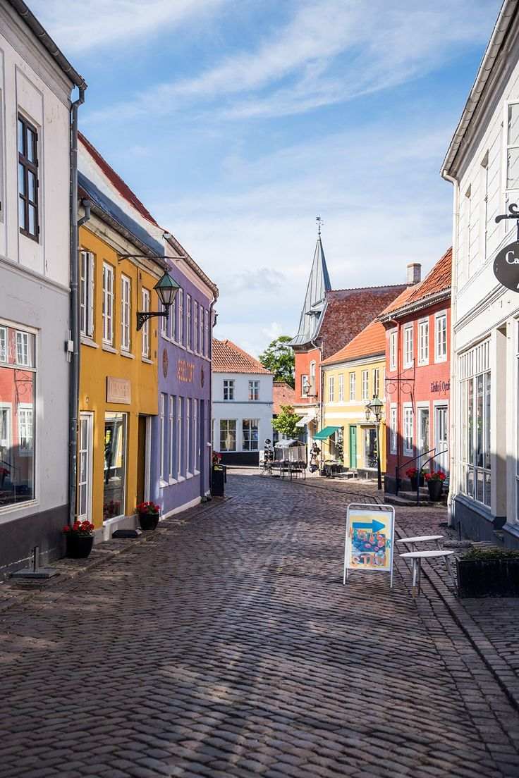 Ebeltoft, Denmark is a beautiful little village in Jutland, and I fell in love with the colorful cobblestone streets and sunny harbor! Denmark Travel Destinations | Denmark Honeymoon | Backpack Denmark | Backpacking | Denmark Vacation | Denmark Photography | Europe #travel #honeymoon #vacation #backpacking #budgettravel #offthebeatenpath #bucketlist #wanderlust #Denmark #Europe #visitDenmark #TravelDenmark #DenmarkTravel