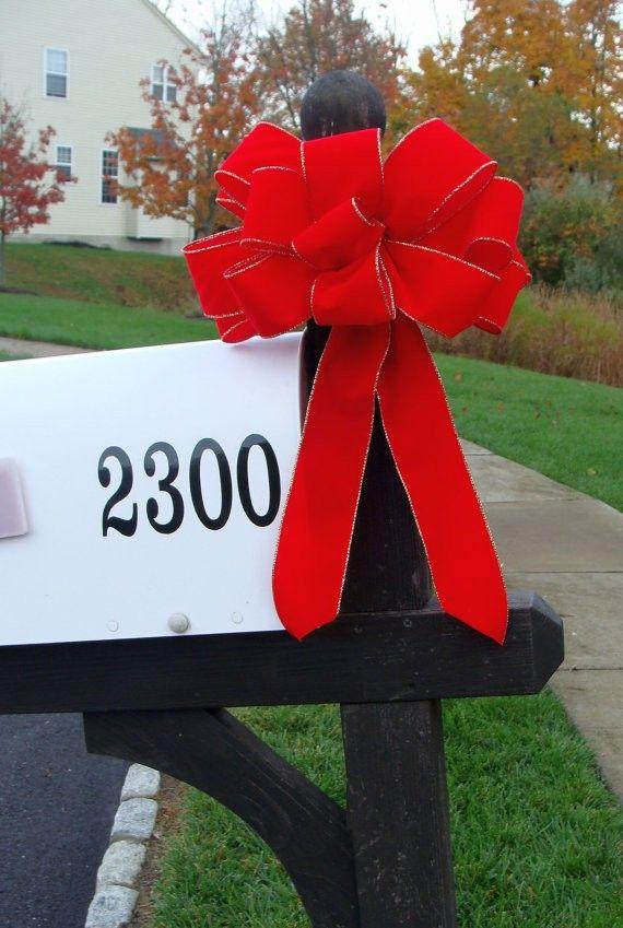 2013 Christmas mailbox cover decor, big red bow mail box decor #2013 #christmas #mailbox #decor www.loveitsomuch.com