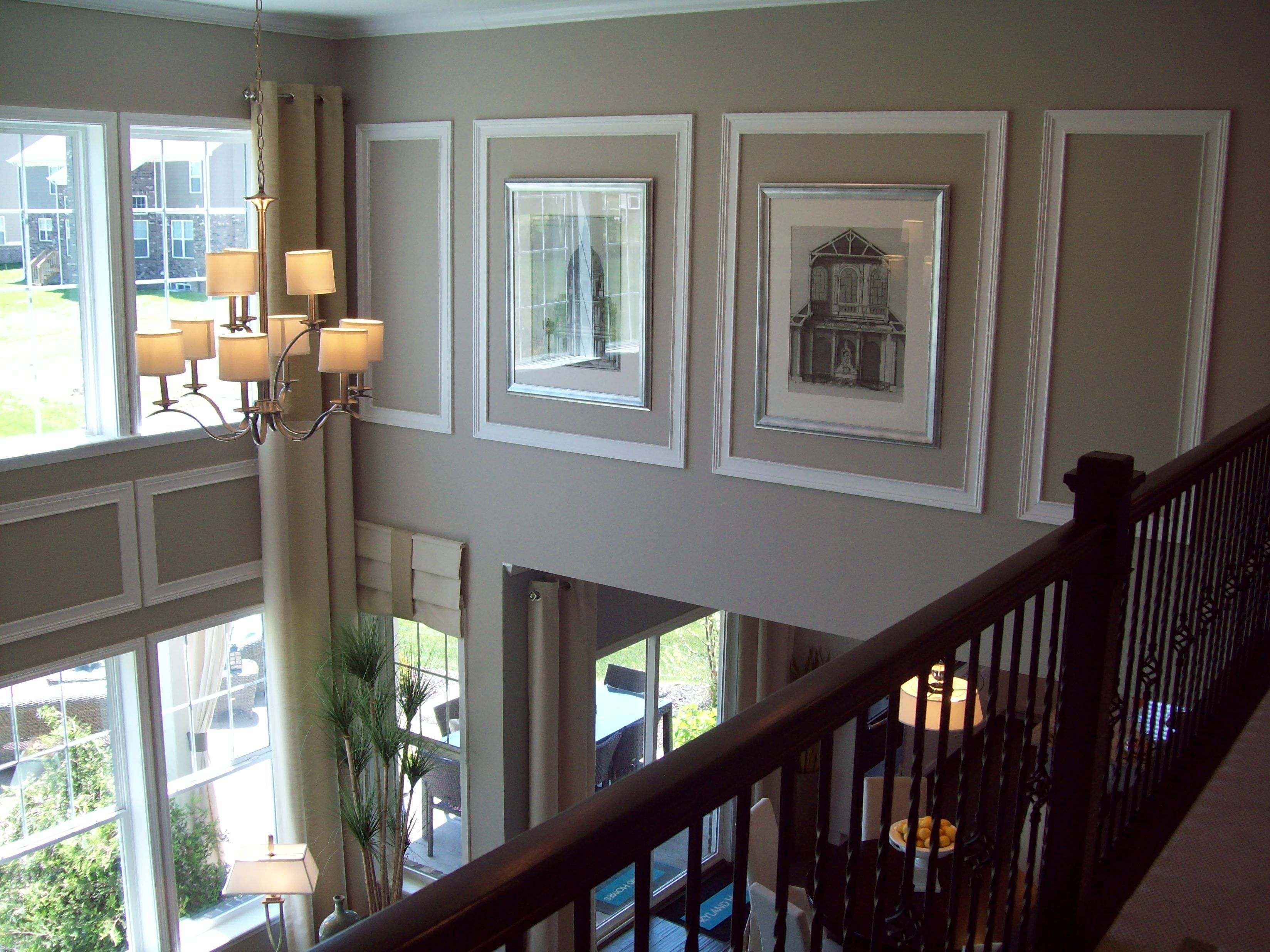 How To Decorate A Long Wall In The Living Room Using Wall Trim And