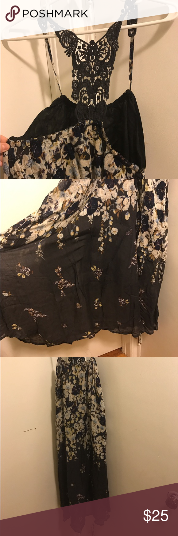 Anthropologie Dress Flowy navy blue with floral dress. Lace detail on the back. Lined. Lilka brand from Anthro. 100% rayon, hand wash cold. Super cute, never worn... took the tags off though. This would easily fit a size large too! Anthropologie Dresses Midi