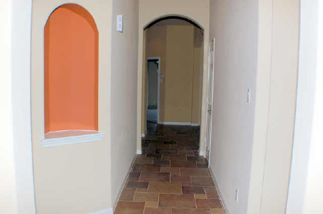 Slate foyer leads to living area with access to bedrooms