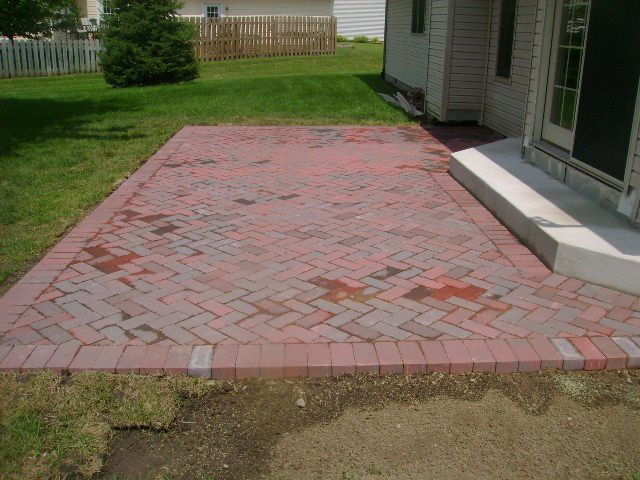 brick patio designs backyard with large pinwheel pattern patio bordered with built in wooden bench patios - Patio Brick Designs