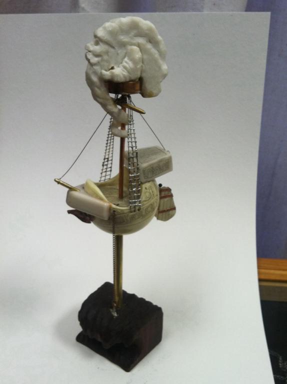Scrimshaw 3D ship on a cue ball.