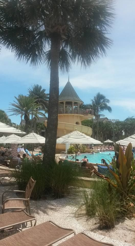 Disney Vero Beach Resort, Pool Area.  Activities for young and old alike.  Great slides, Pool Bar, many amenities #DisneyVacationClub