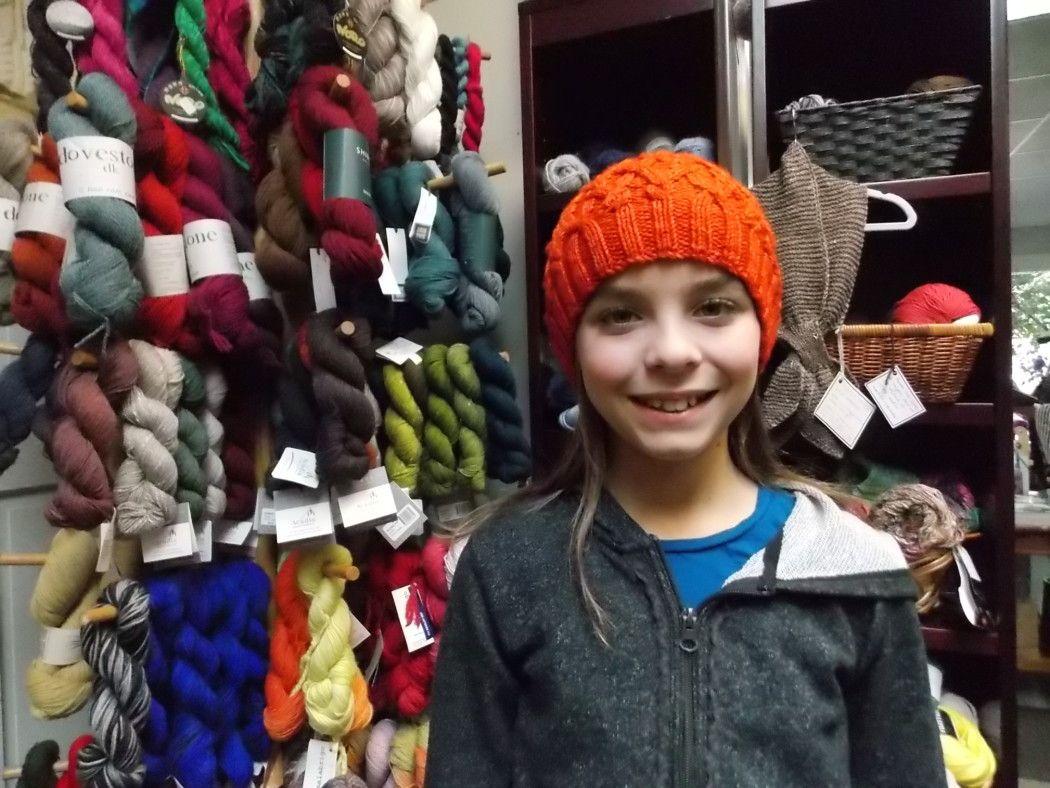 "Margie's granddaughter models the ""Seathwaite"" cap Margie knit for her using Malabrigo Rios."