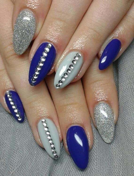 There are so many types and styles of nail designs 2015 are available. Find  the 30 quick and easy silver nail design ideas 2015 in London, UK. - Blue And Silver Nails With Glitter, A Beautiful And Elegant