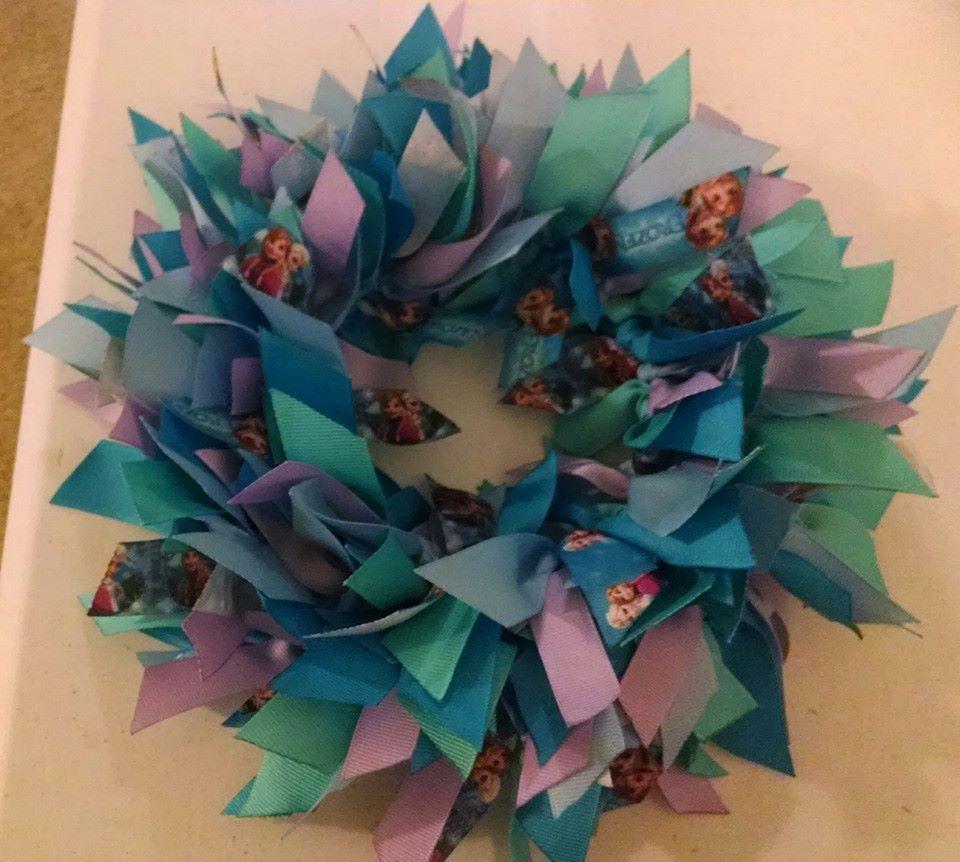 Frozen Ribbon Wreath  https://www.etsy.com/shop/tomfam18?ref=hdr_shop_menu