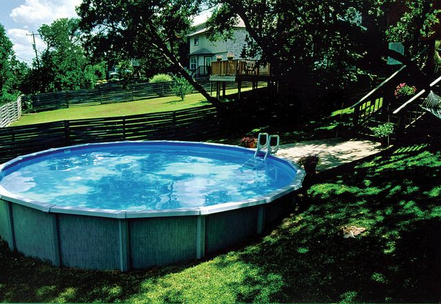 Above ground pool in sloped backyard in 2019 backyard for Above ground pool decks for small yards