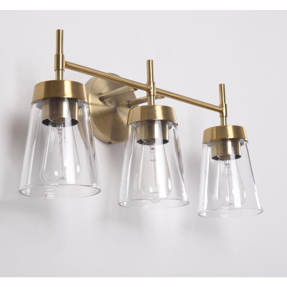 Manor Brook Bea 3 Light Antique Brass Vanity Light With Clear Glass Mb99073 The Home Depot In 2021 Brass Vanity Light Brass Bathroom Lighting Vanity Lighting
