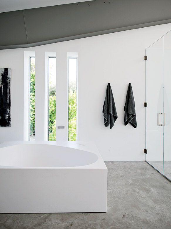 desert canopy house master bathroom with boffi tub travertine