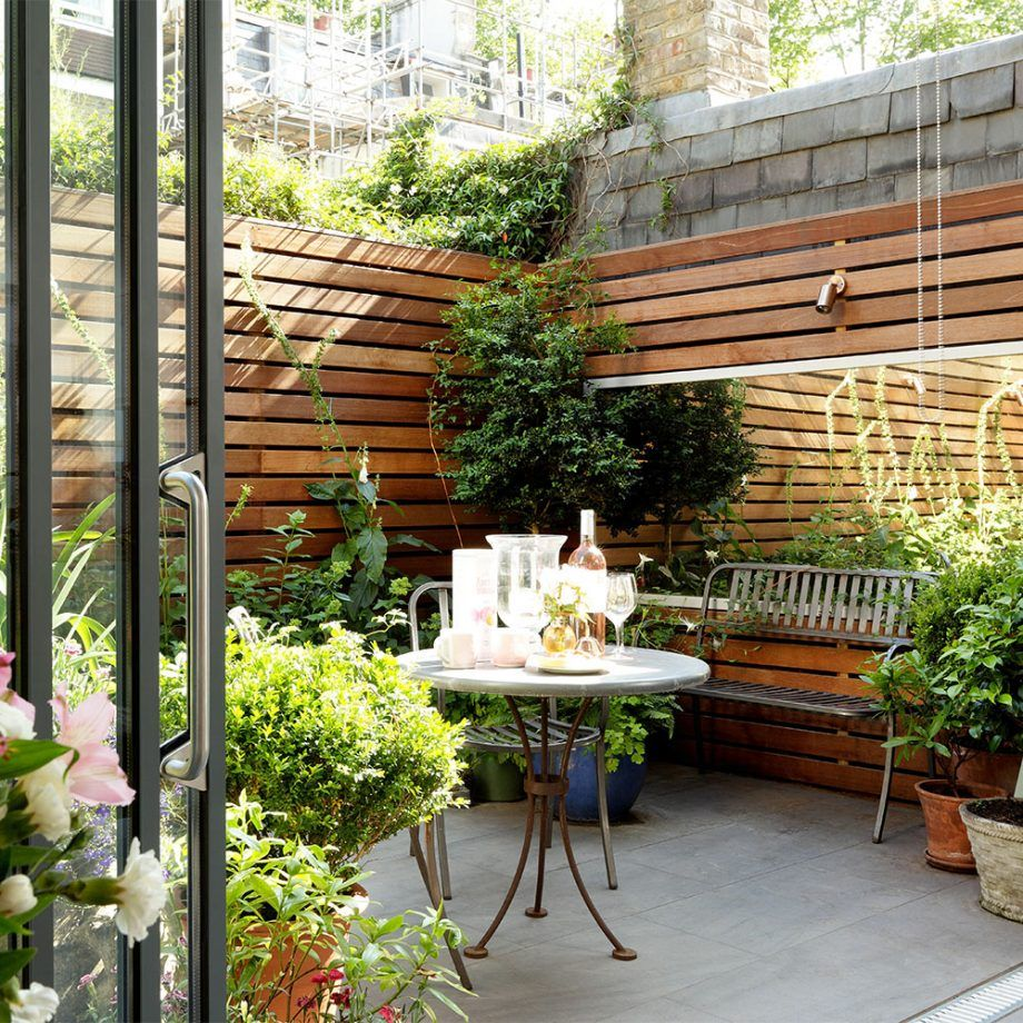 walled courtyard patio garden with tiled floor