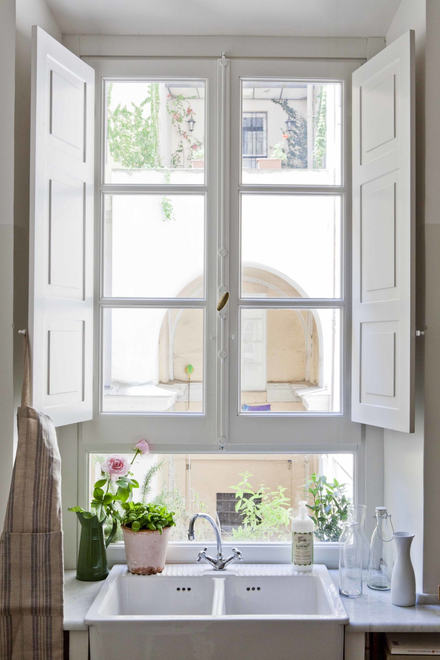 The architects positioned the Ikea sink beneath the window