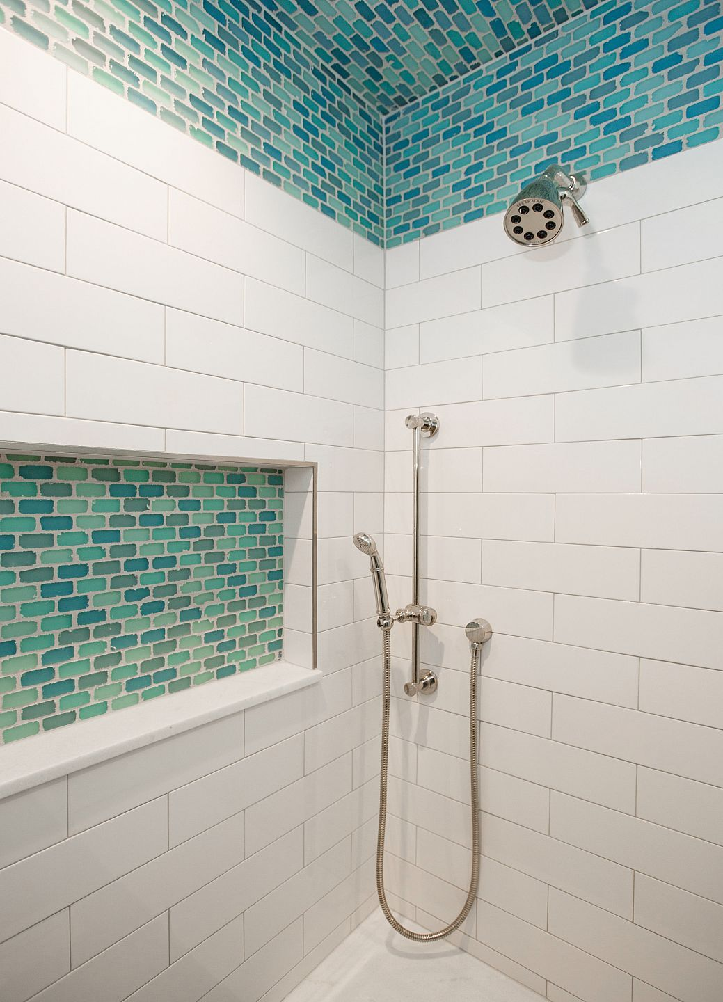 Elongated white subway tile mixed with turquoise accent in tiled shower nook and also top half of interesting lay out best glass images on pinterest