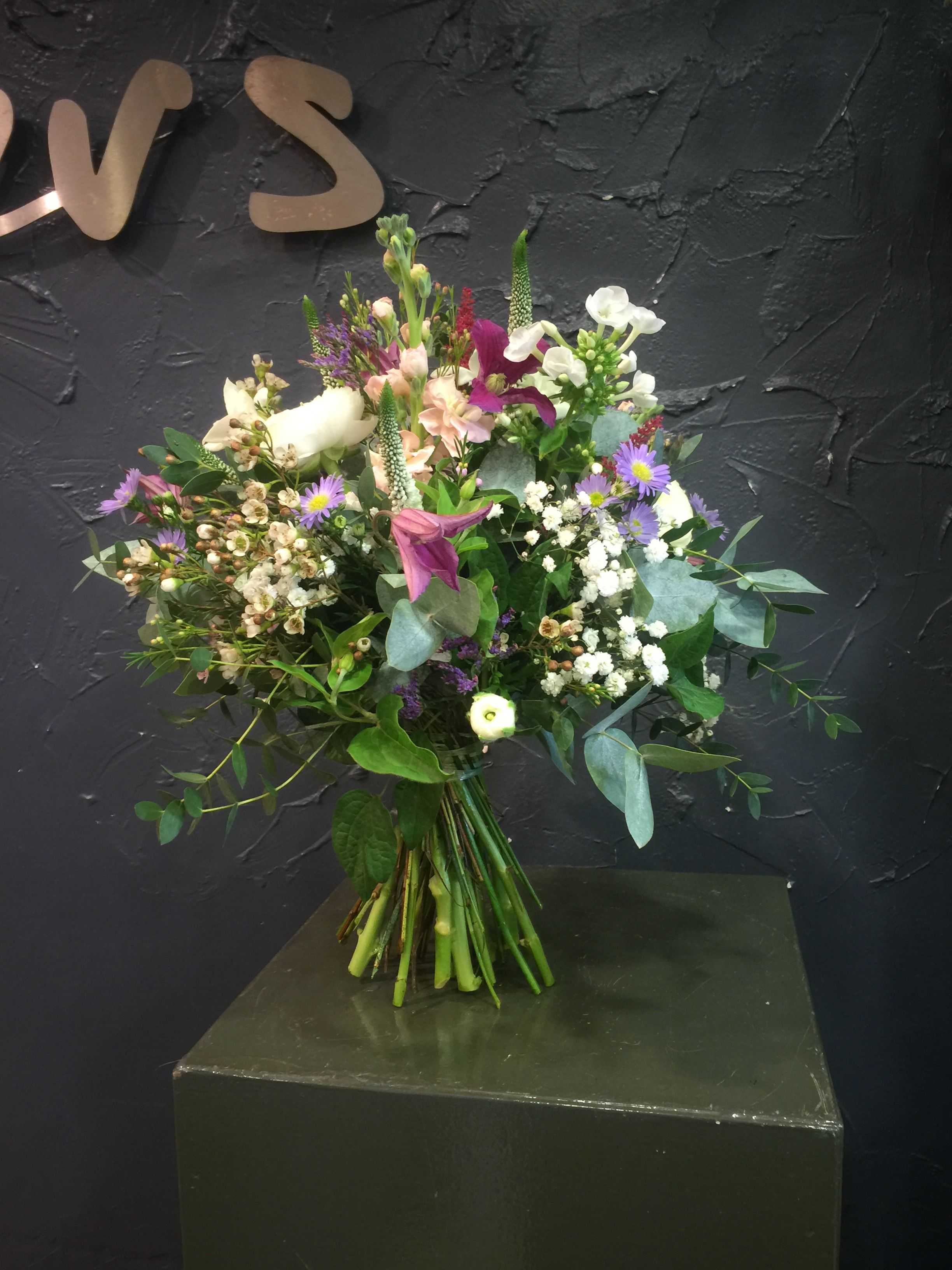 White ranunculus antique stock purple clematis white wax flower