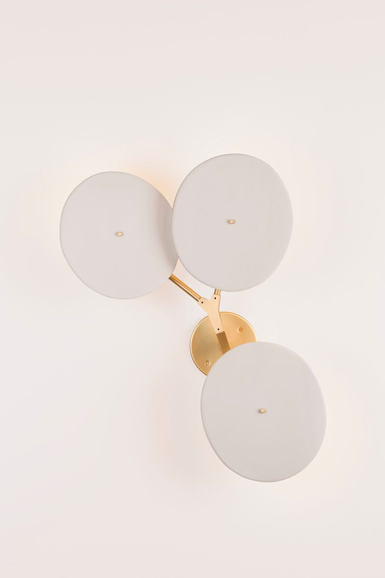 SC.03.02 in brushed brass with white porcelain shadesPhoto by Lauren Coleman