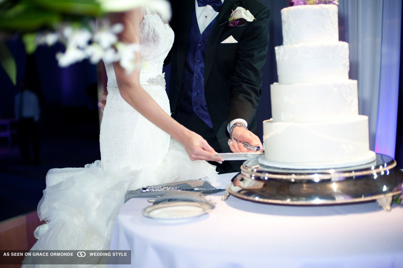 couple cutting wedding cake at denver ctr for performing arts denver colorado #GOWSRedesign