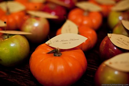 mini pumpkins and apples escort cards